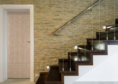 Wooden stairway and brick wall